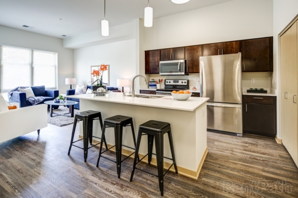 apartment with stainless steel appliances